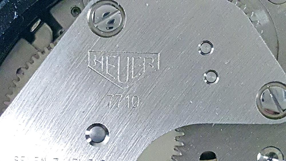 Stopwatch HEUER ref. 502.907 (allsports) --- caliber 7710 (close up on the barrel bridge)
