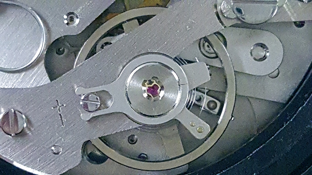 Stopwatch HEUER ref. 502.907 (allsports) --- caliber 7710 (close up of balance wheel and hairspring)