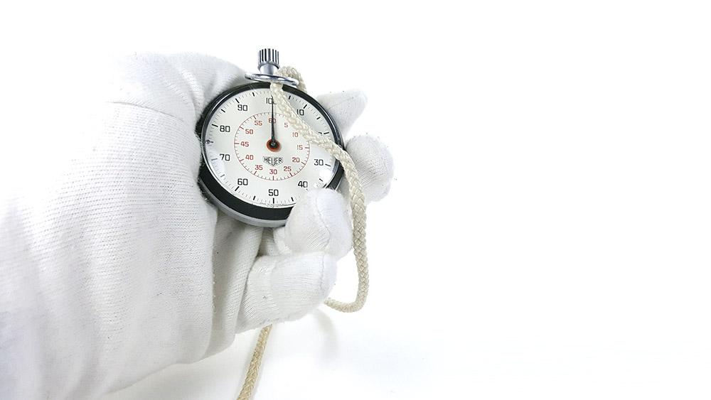 Stopwatch HEUER-LEONIDAS ref. 503.213 --- close up shot hand held --- ikonicstopwatch.com