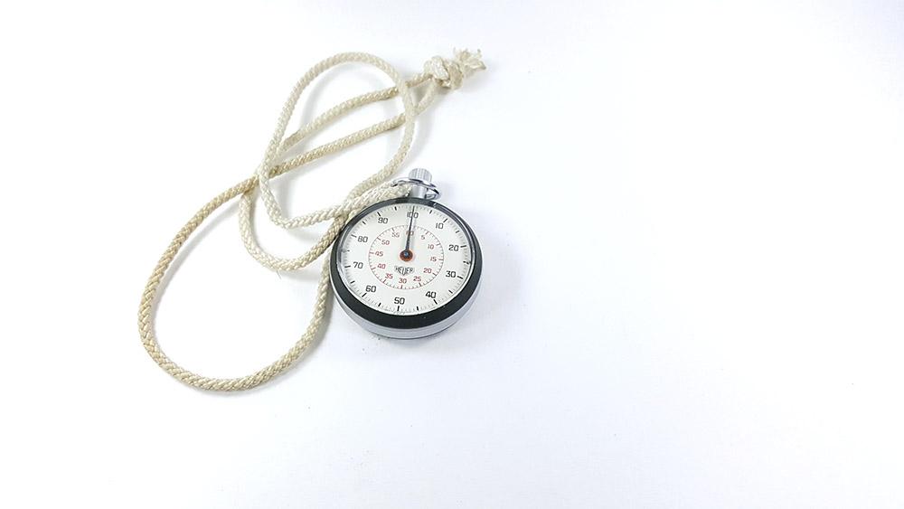 Stopwatch HEUER-LEONIDAS ref. 503.213 --- top view wide shot --- ikonicstopwatch.com