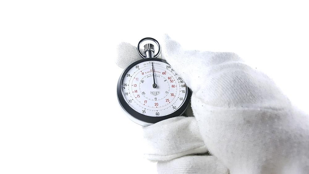 Stopwatch HEUER-LEONIDAS ref. 403.229 --- close shot hand held --- ikonicstopwatch.com