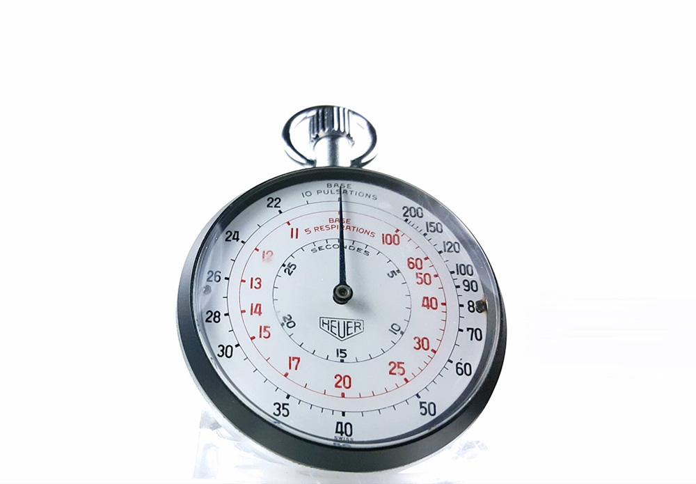 Stopwatch HEUER-LEONIDAS ref. 403.229 --- close-up shot (cover) --- ikonicstopwatch.com
