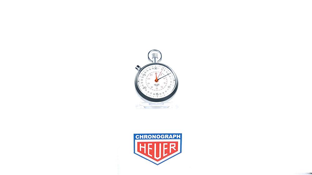 Stopwatch HEUER-LEONIDAS ref. 513.202 with rattrapante (split) --- wide shot --- ikonicstopwatch.com
