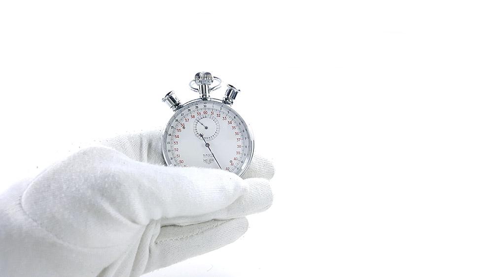 Stopwatch HEUER-LEONIDAS ref. 572 --- close shot hand held --- ikonicstopwatch.com
