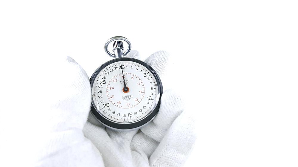 Stopwatch HEUER ref. 503.202 (EMD version) --- whide shot hand held --- ikonicstopwatch.com