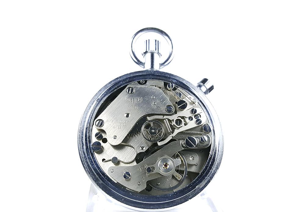 Stopwatch HEUER-LEONIDAS ref. 513.202 (damier dial) --- caliber 7711 (cover) --- ikonicstopwatch.com