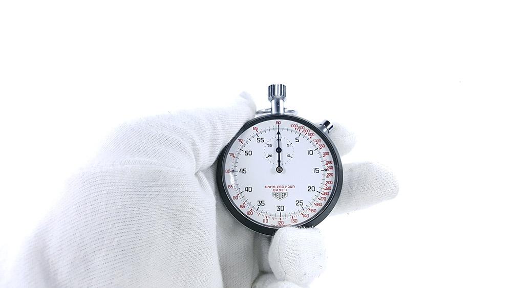 Stopwatch HEUER tachymeter ref. 408.417 --- close shot hand held --- ikonicstopwatch.com
