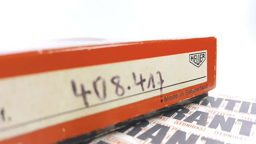 Stopwatch HEUER tachymeter ref. 408.417 --- zoom on the box and guarantee booklet --- ikonicstopwatch.com