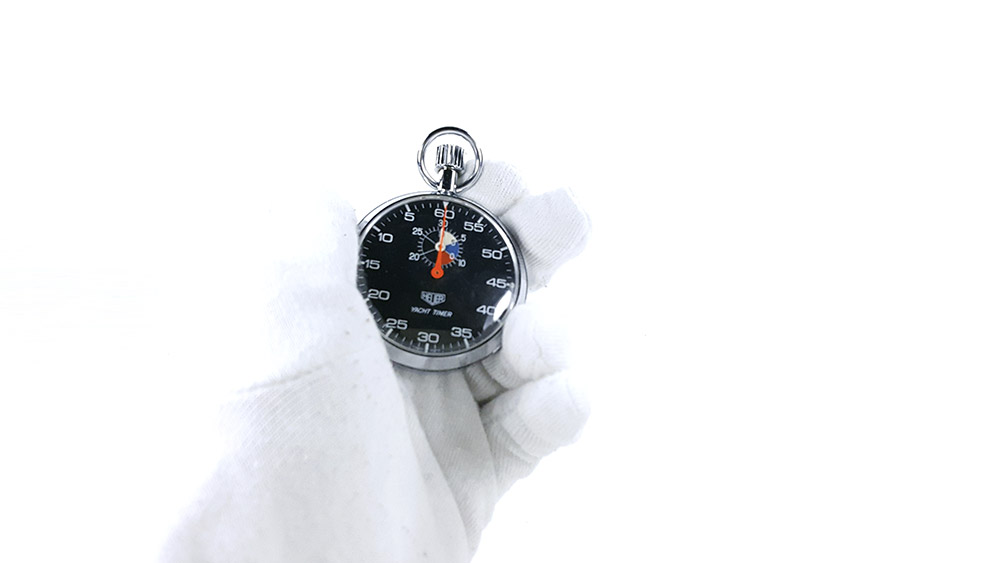 Stopwatch HEUER yacht timer (black dial) ref. 603.615 --- close shot hand held --- ikonicstopwatch.com