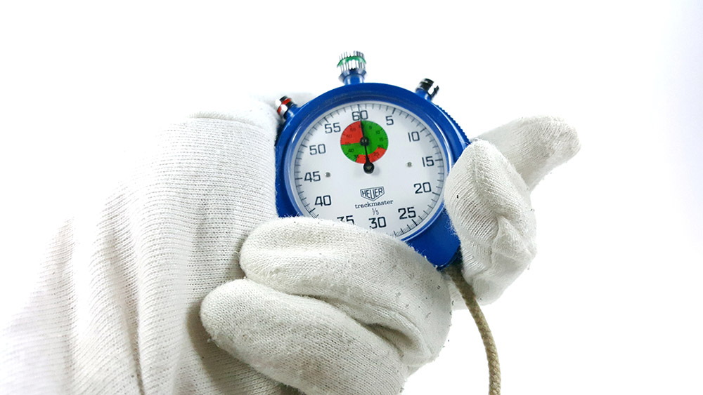 Stopwatch HEUER-Leonidas 8047 (trackmaster) --- close shot hand held --- ikonicstopwatch.com