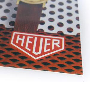 Vintage commercial HEUER leaflet (golden hours) --- logo close-up (cover) --- ikonicstopwatch.com