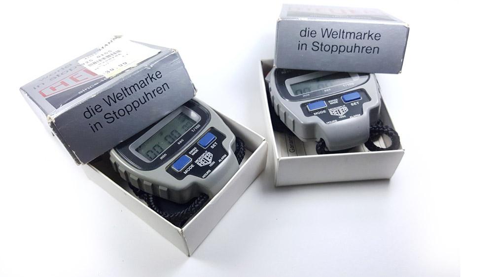 Vintage HEUER-Leonidas stopwatch microsplit ref. 1000 --- two stopwatches in their box --- ikonicstopwatch.com