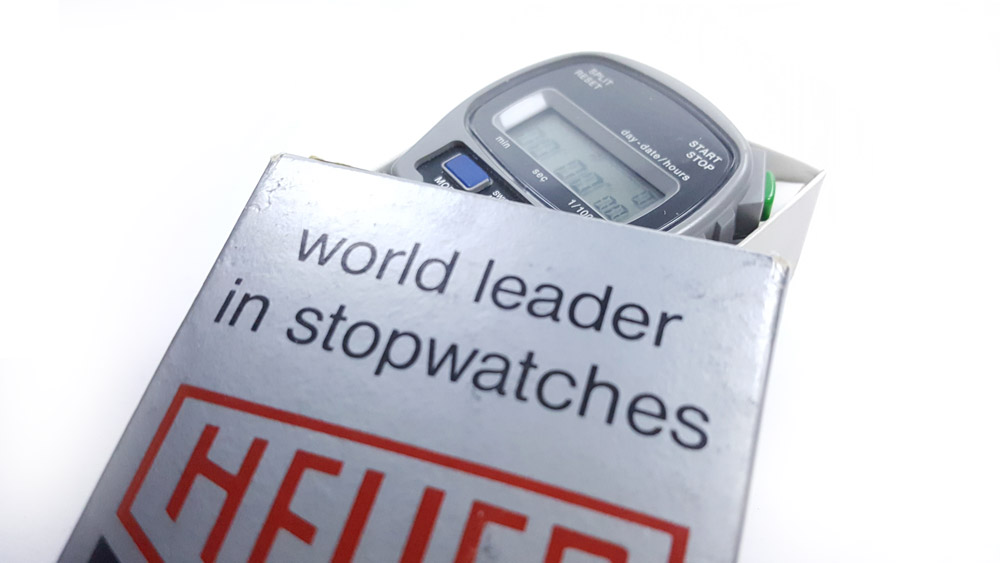 Vintage HEUER-Leonidas stopwatch microsplit ref. 1000 --- box opened --- ikonicstopwatch.com