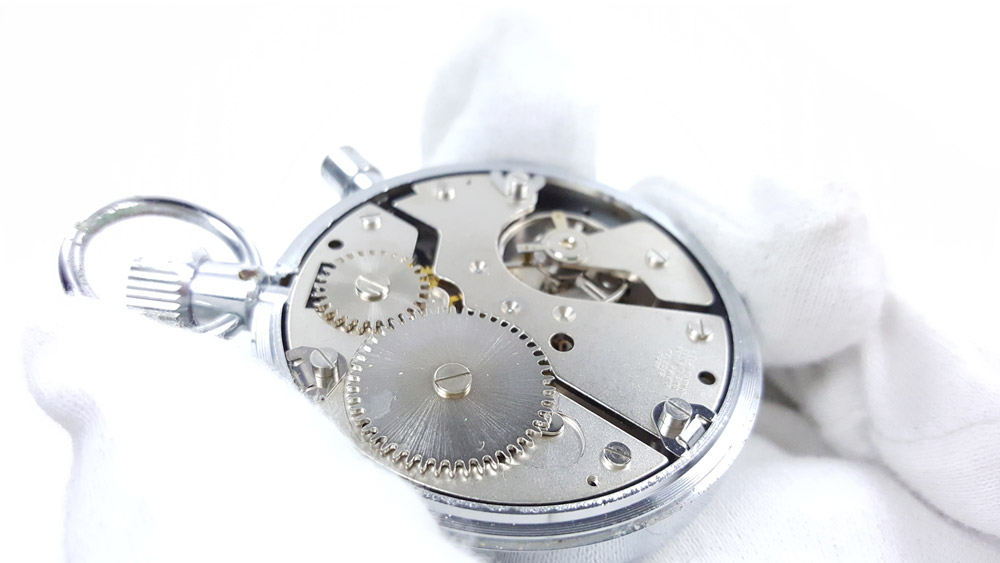 Vintage HEUER-Leonidas stopwatch ref. 593 trackmate --- calibre --- ikonicstopwatch.com