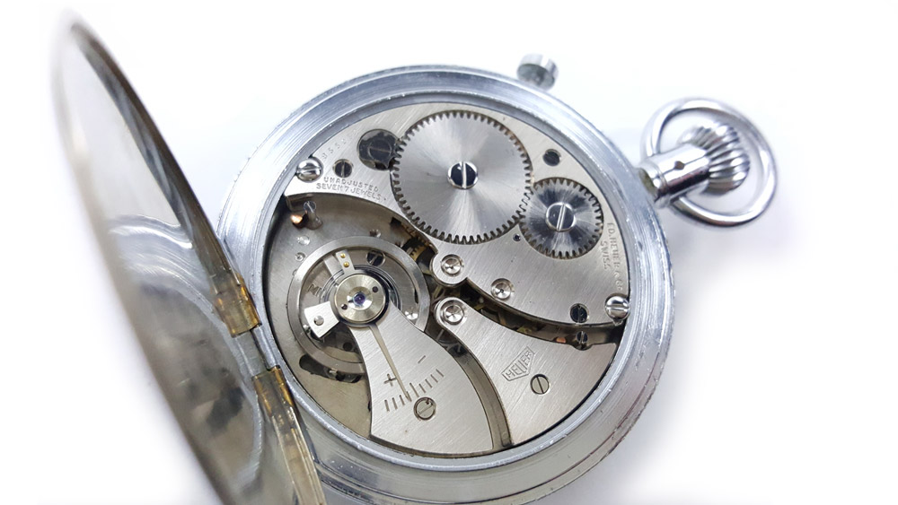 Vintage HEUER S.A.V.I.C stopwatch ref. 924 decimal hour with flyback function --- caliber --- ikonicstopwatch.com