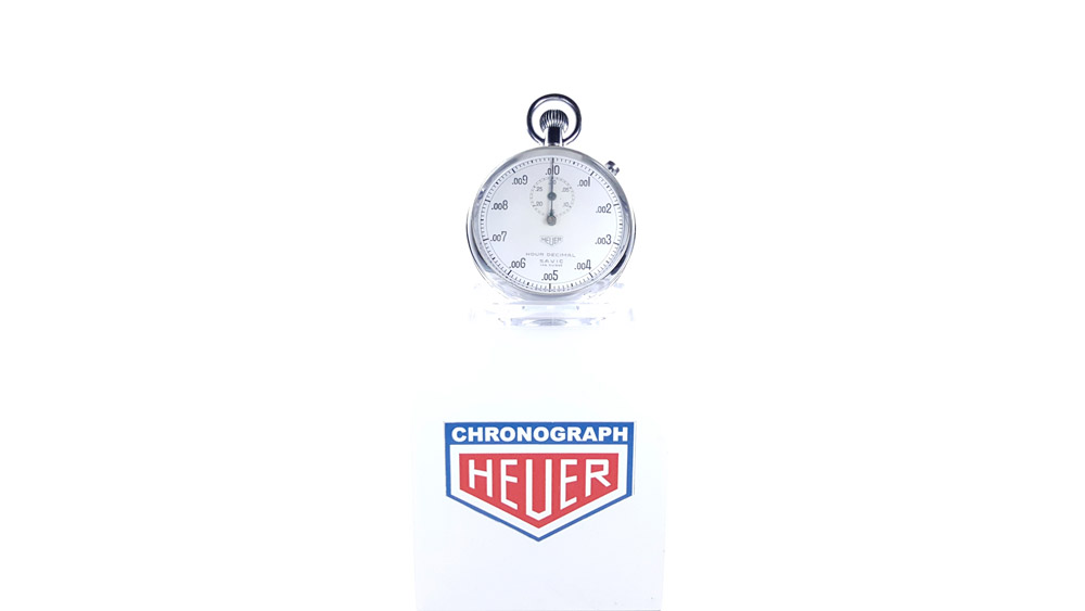 Vintage HEUER S.A.V.I.C stopwatch ref. 924 decimal hour with flyback function --- wide shot --- ikonicstopwatch.com