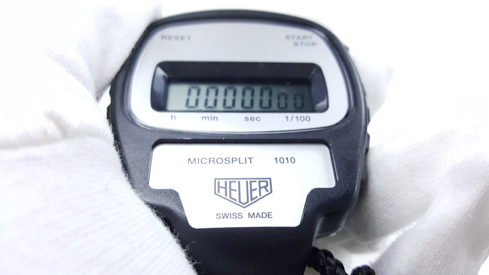 Vintage HEUER stopwatch ref. 1010 microsplit --- close-up shot (hand held) --- ikonicstopwatch.com