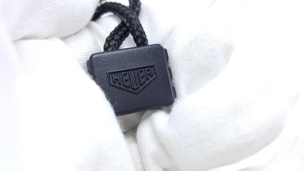 Vintage HEUER stopwatch ref. 1010 microsplit --- zoom on the logo --- ikonicstopwatch.com