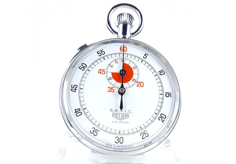 Vintage HEUER stopwatch ref. 907 (version S.A.V.I.C) --- close-up shot --- ikonicstopwatch.com