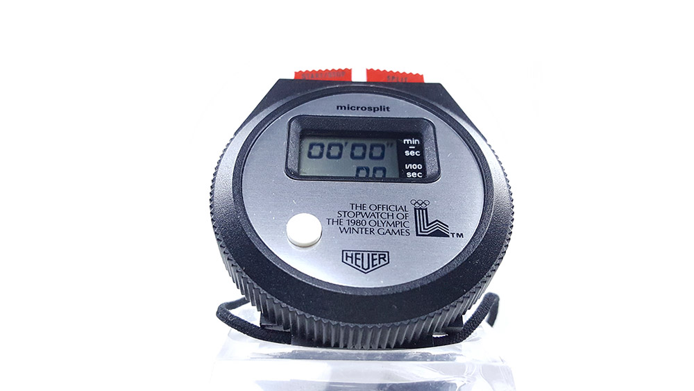 Vintage HEUER stopwatch ref. 230 microsplit (lake placid olympic games version) --- close side view --- ikonicstopwatch.com