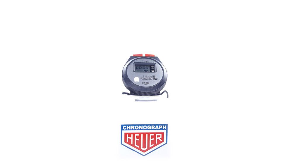 Vintage HEUER stopwatch ref. 230 microsplit (lake placid olympic games version) --- wide shot --- ikonicstopwatch.com