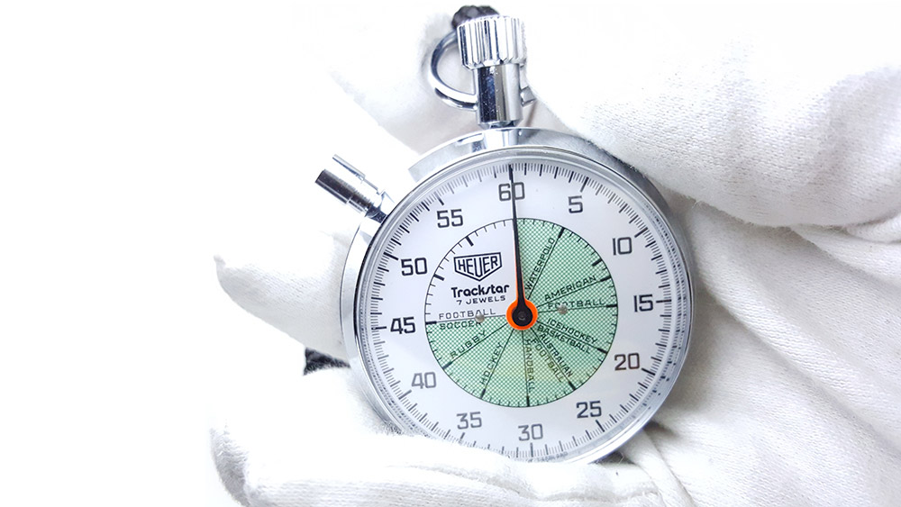 Vintage HEUER stopwatch ref. 653.302 trackstar (allsports) --- close shot hand held --- ikonicstopwatch.com